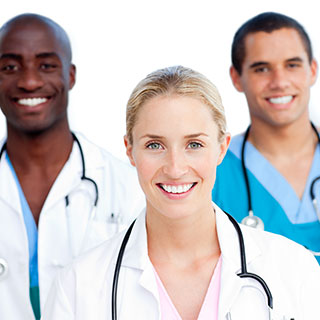 Physicians smiling in a group.