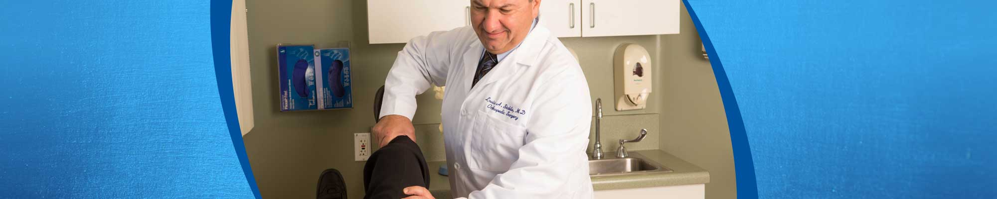 A doctor assessing a patient's knee.